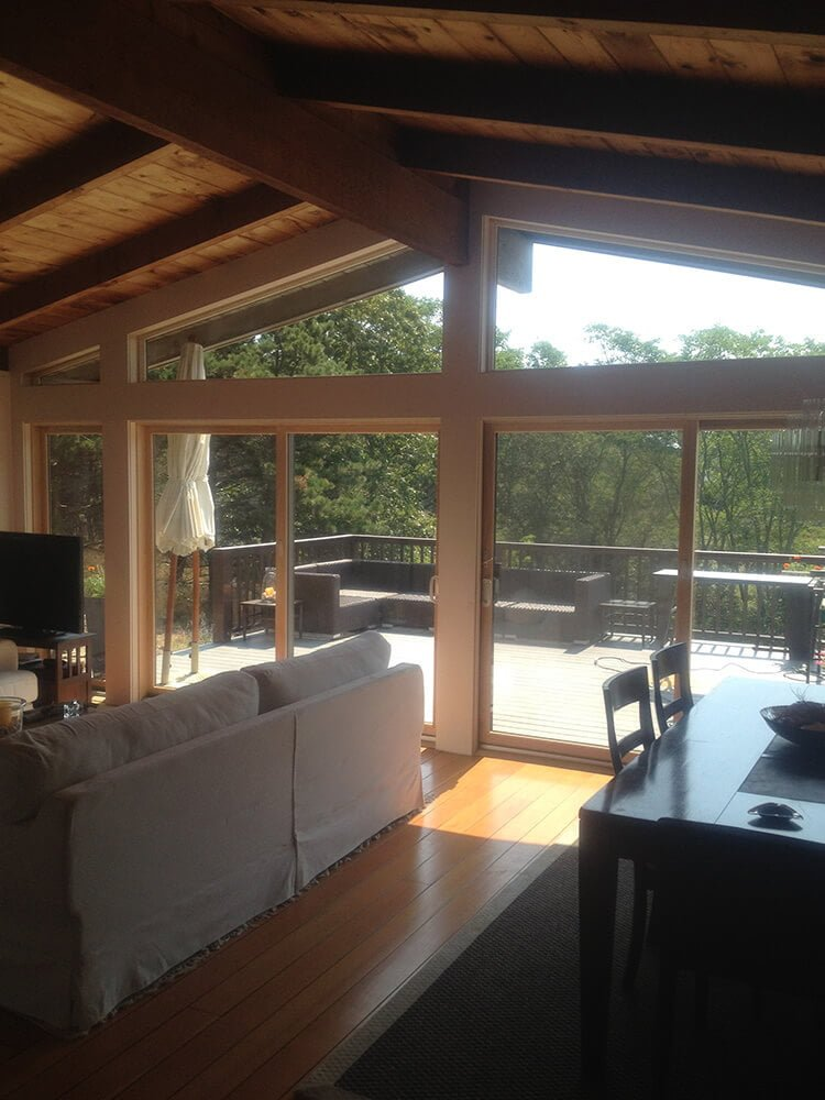Mike Hunter glass sliding doors and trapezoid windows as well as framing.on Cape Cod